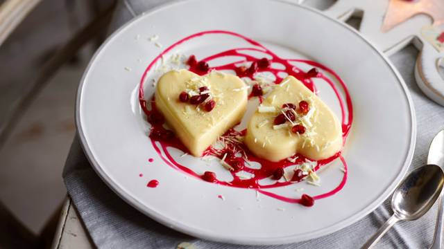 Cream lime heart with a pomegranate sauce