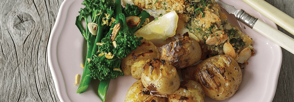 Herby crumbed fish with smashed potatoes and roasted broccoli